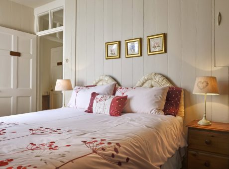 Bedroom with Red Pillows