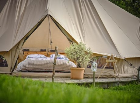 Front view of glamping tent with grass in the foreground