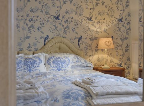 Farmhouse Bedroom with Blue pretty wall paper